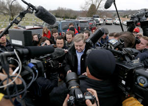 Republican Rick Saccone, center, is makes his way through a gang of cameras and reporters as he heads to the polling place to cast his ballot,Tuesday, March 13, 2018 in McKeesport, Pa.