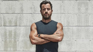 Justin Theroux standing in front of a building: How Justin Theroux Is Using Workouts to Cope After Jennifer Aniston Split