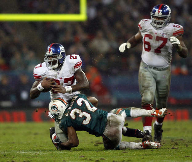 New York Giants (left) Brandon Jacobs is tackled by Miami Dolphins  Jason  Allen 6306e2bce