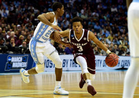 CAPTION: CHARLOTTE, NC - MARCH 18: Admon Gilder #3 of the Texas A&M Aggies drives to the basket against Kenny Williams #24 of the North Carolina Tar Heels during the second round of the 2018 NCAA Men's Basketball Tournament at Spectrum Center on March 18, 2018 in Charlotte, North Carolina.