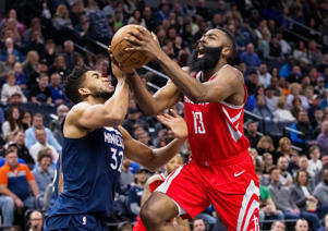 Mar 18, 2018; Minneapolis, MN, USA; Minnesota Timberwolves center Karl-Anthony Towns (32) fouls Houston Rockets guard James Harden (13) in the second quarter at Target Center.