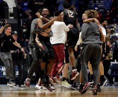 Florida State player celebrate after defeating Xavier during a second-round game in the NCAA college basketball tournament in Nashville, Tenn., Sunday, March 18, 2018. Florida State defeated Xavier 75-70. (AP Photo/Mark Humphrey)