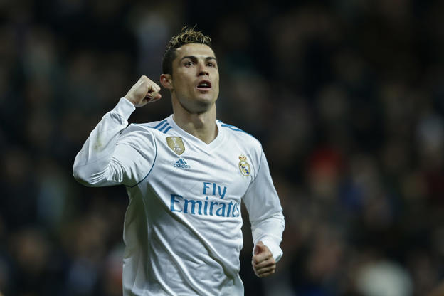 Real Madrid's Cristiano Ronaldo celebrates after scoring his side's fifth goal during a Spanish La Liga soccer match between Real Madrid and Real Sociedad at the Santiago Bernabeu stadium in Madrid, Saturday, Feb. 10, 2018. (AP Photo/Francisco Seco)