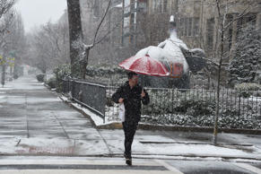 A pedestrian weathers the latest storm to hit the US east coast on March 21, 2018, in Washington, DC.