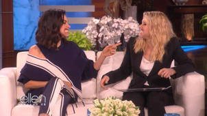 a person sitting at a table eating food: Mila Kunis and Kate McKinnon couldn't stop laughing on 'The Ellen DeGeneres Show'