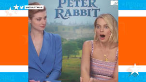 a man and a woman posing for a picture: Margot Robbie gets interviewed by her brother