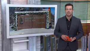Carson Daly holding a sign posing for the camera: Why one university is planning to drop English, history and 11 other majors