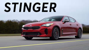 a red car parked on the side of a road: 2018 Kia Stinger Road Test