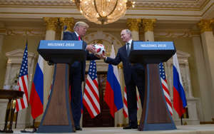 Russian President Vladimir Putin, right, presents a soccer ball to U.S. President Donald Trump, left, during a press conference after their meeting at the Presidential Palace in Helsinki, Finland, Monday, July 16, 2018. (AP Photo/Pablo Martinez Monsivais)
