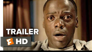 a man looking at the camera: Starring: Bradley Whitford, Allison Williams, Betty Gabriel  Get Out Official Trailer 1 (2017) - Daniel Kaluuya Movie  A young African American man visits his Caucasian girlfriend's cursed family estate.  Subscribe to TRAILERS: http://bit.ly/sxaw6h Subscribe to COMING SOON: http://bit.ly/H2vZUn We're on SNAPCHAT: http://bit.ly/2cOzfcy Like us on FACEBOOK: http://bit.ly/1QyRMsE Follow us on TWITTER: http://bit.ly/1ghOWmt  The Fandango MOVIECLIPS Trailers channel is your destination for the hottest new trailers the second they drop. Whether it's the latest studio release, an indie horror flick, an evocative documentary, or that new RomCom you've been waiting for, the Fandango MOVIECLIPS team is here day and night to make sure all the best new movie trailers are here for you the moment they're released.  In addition to being the #1 Movie Trailers Channel on YouTube, we deliver amazing and engaging original videos each week. Watch our exclusive Ultimate Trailers, Showdowns, Instant Trailer Reviews, Monthly MashUps, Movie News, and so much more to keep you in the know.  Here at Fandango MOVIECLIPS, we love movies as much as you!