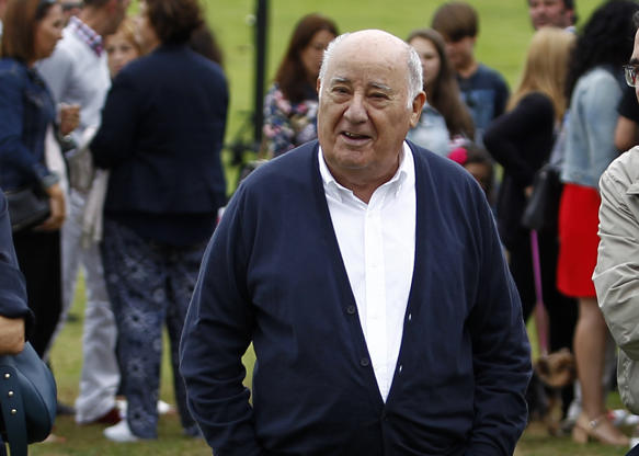 Slide 19 of 20: In this July 30, 2016 photo, Amancio Ortega Gaona, founding shareholder of Inditex fashion group, best known for its chain of Zara clothing and accessories retail shops, walks during the Casas Novas International Jumping Show in Arteixo, A Coruña, in the Galicia region of northwest Spain. Amancio Ortega, has been named as the richest person in Europe, and the second richest in the whole world. (AP Photo/Iago Lopez)