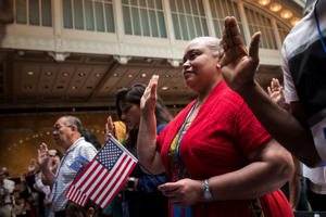 NEW YORK, NY - JULY 3: New U.S. citizens recite the Oath of Allegiance during naturalization ceremony at the New York Public Library, July 3, 2018 in New York City. 200 immigrants from 50 countries became citizens during the ceremony, one day before America's Independence Day. (Photo by Drew Angerer/Getty Images)