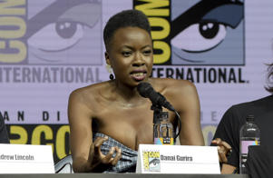 "Danai Gurira speaks at a panel for ""The Walking Dead"" on day two of Comic-Con International on Friday, July 20, 2018, in San Diego. (Photo by Richard Shotwell/Invision/AP)"