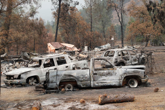 Slide 1 of 33: A home and driveway of cars damaged from the Ranch Fire near Clearlake Oaks, California, USA, 07 August 2018.