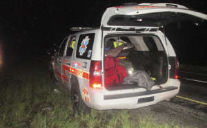 This photo provided by U.S Customs and Border Protection shows an SUV falsely decked out as an emergency response vehicle near the border in Falfurrias, Texas. Officers have caught the driver and three immigrants who fled through a South Texas border checkpoint in the SUV. Border Patrol Agent Carlos Ruiz said Wednesday, Aug. 8, 2018, that investigators believe it's a fake fire/emergency medical services vehicle and the driver pretended to be an off-duty employee. (U.S. Customs and Border Protection via AP)