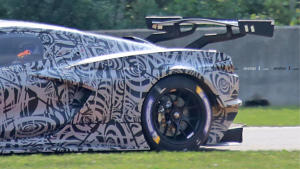 a truck that is sitting on the grass: Mid-engine Corvette C8.R Race Car Spy Photos