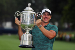 ST LOUIS, MO - AUGUST 12:  Brooks Koepka of the United States poses with the Wanamaker Trophy on the 18th green after winning the 2018 PGA Championship with a score of -16 at Bellerive Country Club on August 12, 2018 in St Louis, Missouri.  (Photo by Richard Heathcote/Getty Images)
