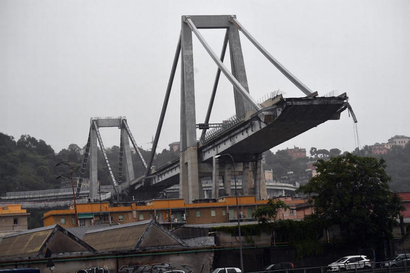 The elevated motorway bridge collapsed as heavy rain fell on Genoa around 11.30am local time