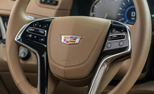 a close up of a car: 2018 Cadillac Escalade ESV steering wheel