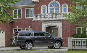 a car parked in front of a brick building: Exterior Design and Dimensions