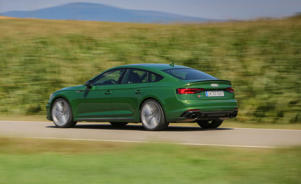 a car driving on a lush green field: The Audi RS5 Sportback Makes the Case for High-Performance Hatchbacks