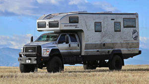 a truck is parked on the side of a vehicle: Earthroamer XV-HD Ford F-750