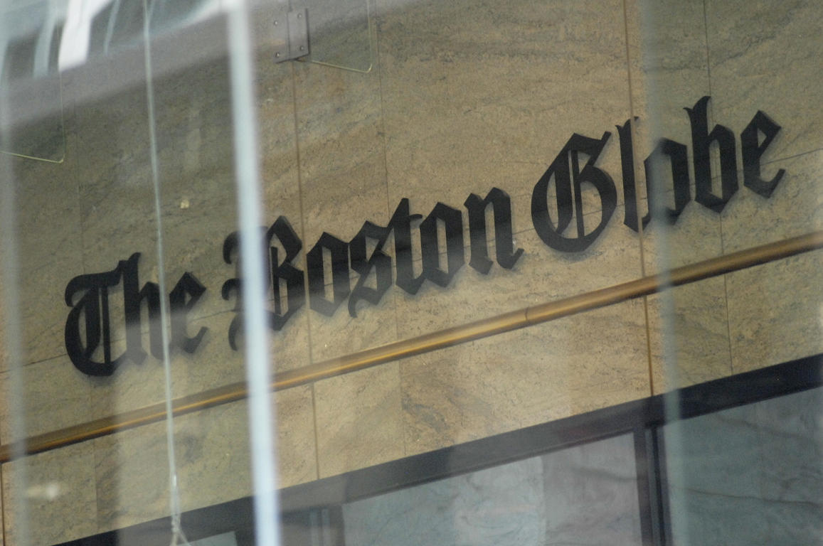 The Boston Globe logo as seen through the windows across from the new location of the Boston Globe at 53 State Street, Boston, at one Exchange Place in the Exchange Building on August 15, 2018. (Photo by Joseph PREZIOSO / AFP)        (Photo credit should read JOSEPH PREZIOSO/AFP/Getty Images)