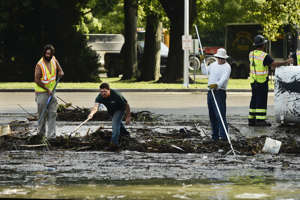 Crews attempt to clean up the waterfront along Seneca Lake at Lodi Point in Lodi, N.Y., Wednesday, Aug. 15, 2018, after flash flooding damaged homes, vehicles and infrastructure from the Finger Lakes region to the Binghamton area on Tuesday. (AP Photo/Heather Ainsworth)