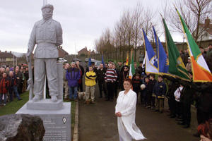 Members of an INLA (Irish National Liberation Army ) colour party looks on during the official unveiling of a statue at the INLA burial plot in Londonderry city cemetery.