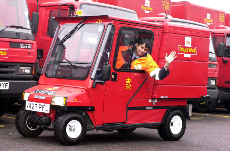 Nav Vyas, a postman from Oxford, demonstrates the Royal Mail's new electric mail cart for delivering post in busy city centres, in London. The  carryall has a top speed of 18 mph and can carry loads of more than 250 kilos, and is charged up over night.   * The cart, which looks remarkably like a grown up version of Postman Pat's famous red van.   (Photo by Fiona Hanson - PA Images/PA Images via Getty Images)
