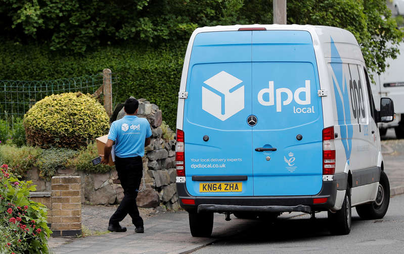 A dpd local delivery driver takes a parcel from his van in Shepshed, Britain June 5, 2018.  REUTERS/Darren Staples