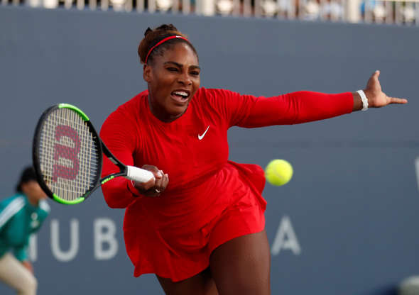 Serena Williams, of the United States, returns the ball to Johanna Konta, from Britain, during the Mubadala Silicon Valley Classic tennis tournament in San Jose, Calif., Tuesday, July 31, 2018. Konta won 6-1, 6-0.