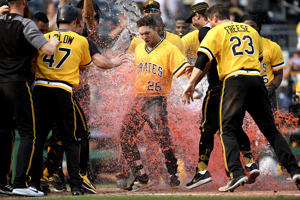 PITTSBURGH, PA - AUGUST 19: Adam Frazier #26 of the Pittsburgh Pirates is dumped with powerade by teammates as he crosses home plate after hitting a walk off home run to give the Pittsburgh Pirates a 2-1 win over the Chicago Cubs in eleven innings at PNC Park on August 19, 2018 in Pittsburgh, Pennsylvania. (Photo by Justin Berl/Getty Images)