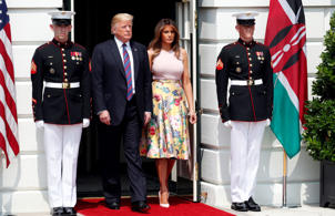 President Donald Trump and first lady Melania Trump arrive to greet Kenyan President Uhuru Kenyatta and his wife Margaret Kenyatta as they arrive at the White House, Monday, Aug. 27, 2018, in Washington. (AP Photo/Alex Brandon)