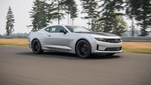 a car parked on the side of a road: 2019 Chevrolet Camaro Turbo 1LE