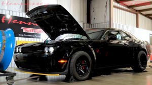 a car parked on the side of a building: Hennessey Dodge Demon HPE1200 Dyno