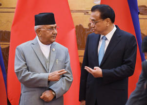 BEIJING, CHINA - JUNE 21: Nepal's Prime Minister K.P. Sharma Oli (L) chats with Chinese Premier Li Keqiang during a signing ceremony at the Great Hall of the People on June 21, 2018,  Beijing, China.  (Photo by Greg Baker-Pool/Getty Images)