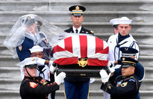 The casket of Senator John McCain, R-Ariz., is carried down the steps of the U.S. Capitol in Washington, U.S. September 1, 2018. Marvin Joseph/Pool via REUTERS