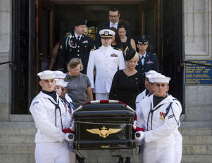 In this image provided by the U.S. Navy, Navy Body Bearers walk with the casket of Sen. John McCain, R-Ariz., followed by family members including Cindy McCain, to place it onto a horse-drawn caisson after his funeral service at the United States Naval Academy Chapel, Sunday, Sept. 2, 2018, in Annapolis, Md.