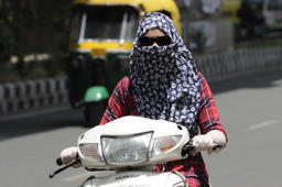 Now, fine for women riding without helmet