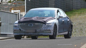 a car parked on the side of a road: New Genesis G80 spy photo