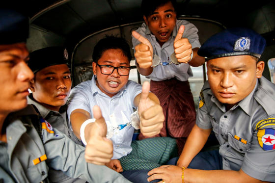 Slide 1 of 30: Reuters journalists Wa Lone (C) and Kyaw Soe Oo gesture as they prepare to leave the Insein township court in Yangon, Myanmar, 03 September 2018.