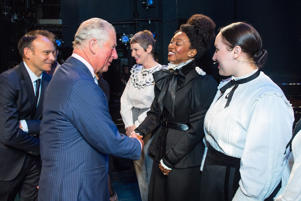 The Prince of Wales meets Beverley Knight and members of the cast of 'Sylvia' onstage at the Old Vic Theatre, in central London, during a visit to mark the theatre's 200th anniversary.