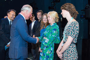 The Prince of Wales meets Sally Greene (centre) onstage at the Old Vic Theatre, in central London, during a visit to mark the theatre's 200th anniversary.