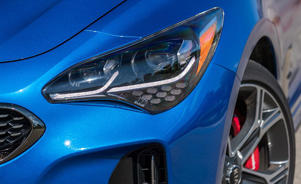 a close up of a blue car: The Kia Stinger GT Continues to Grow on Us