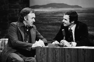 THE TONIGHT SHOW STARRING JOHNNY CARSON -- Pictured: (l-r) Gene Hackman, guest host Burt Reynolds on December 15, 1976 -- Photo by: Frank Carroll/NBC/NBCU Photo Bank