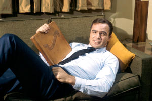 LOS ANGELES, CA - 1966: Actor Burt Reynolds lays on the couch during a scene in his TV show 'Hawk' in 1966 in Los Angeles, California. (Photo by Martin Mills/Getty Images)