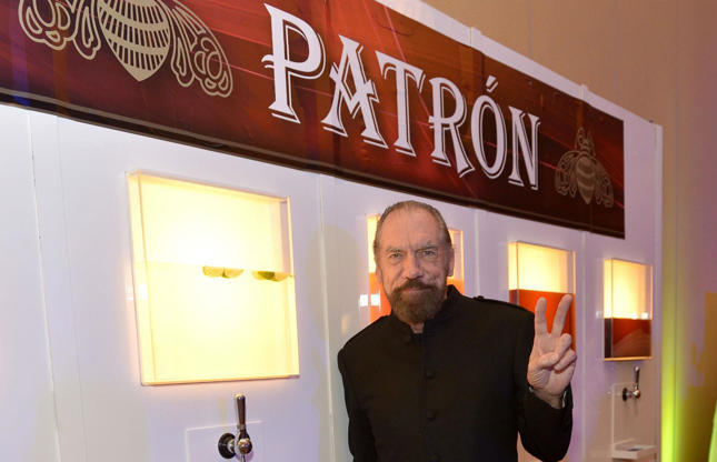"Slide 8 of 67: John Paul DeJoria has a net worth of $2.5 billion (A?1.95bn). He is the co-founder of hair care company John Paul Mitchell Systems, which generates $1 billion (A?770m) in annual revenue, as well as high-end tequila company PatrA?n Spirits, which sells more than two million cases each year. DeJoria doesna??t measure his success in terms of dollars though, his wealth makes him ""feel really good to be financially blessed and give back."""