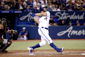 TORONTO, ON - AUGUST 20: Kendrys Morales #8 of the Toronto Blue Jays hits a three-run home run in the fifth inning during MLB game action against the Baltimore Orioles at Rogers Centre on August 20, 2018 in Toronto, Canada. (Photo by Tom Szczerbowski/Getty Images)