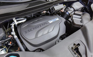 a motorcycle parked next to a car engine: 2019 Honda Pilot